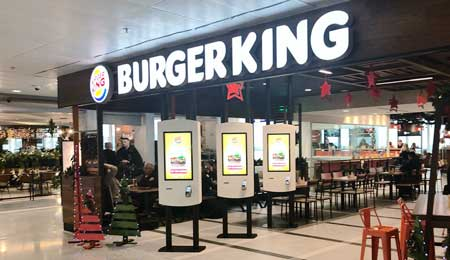Self-service checkout kiosks for the Burger King